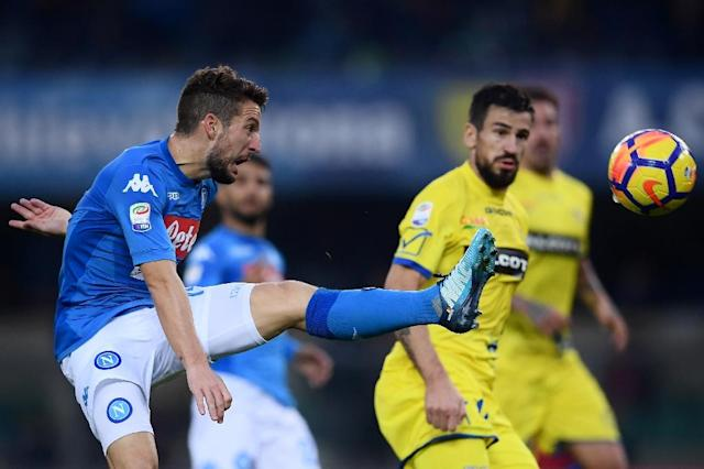 Napoli's Dries Mertens kikcks the ball during their Italian Serie A match against Chievo Verona, at the Marcantonio Bentegodi Stadium in Verona, on November 5, 2017 (AFP Photo/MARCO BERTORELLO)