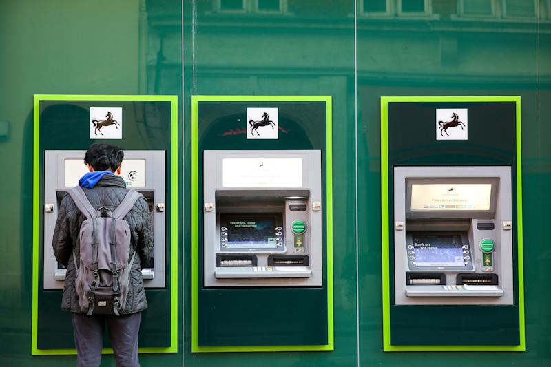 LONDON, UNITED KINGDOM - 2019/12/04: A man using Lloyds Bank's ATM machine in London's West End. (Photo by Dinendra Haria/SOPA Images/LightRocket via Getty Images)