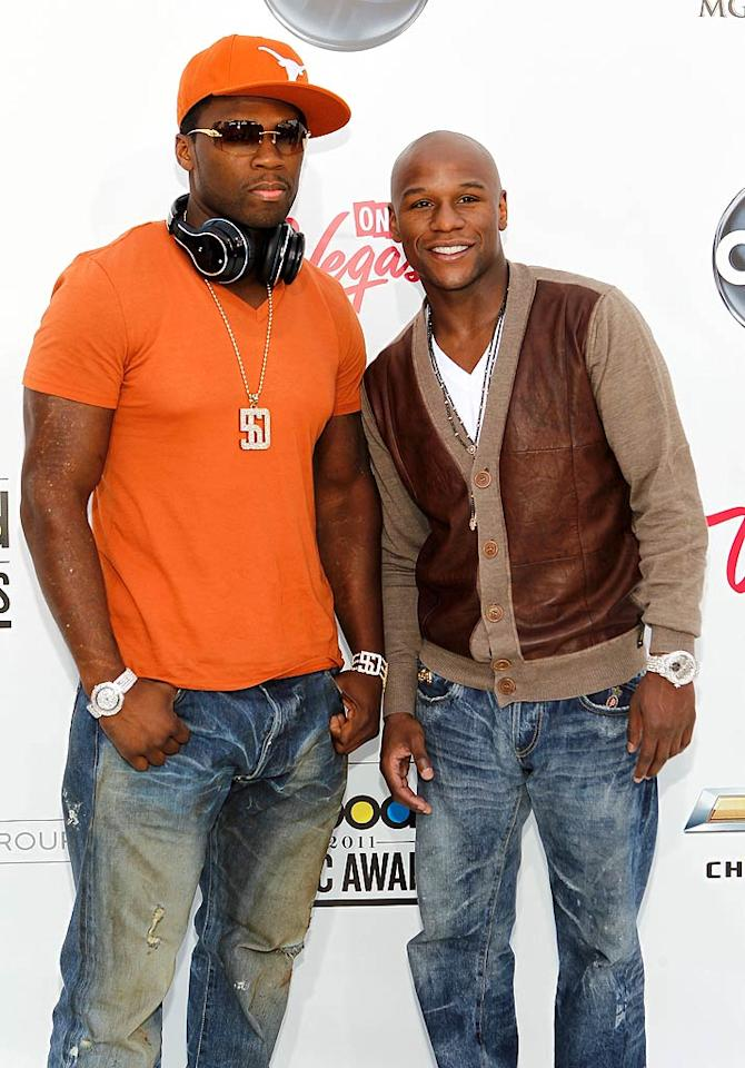 "With his bling and University of Texas gear in place, 50 Cent made the scene with his BFF, boxer Floyd Mayweather. Isaac Brekken/<a href=""http://www.gettyimages.com/"" target=""new"">GettyImages.com</a> - May 22, 2011"