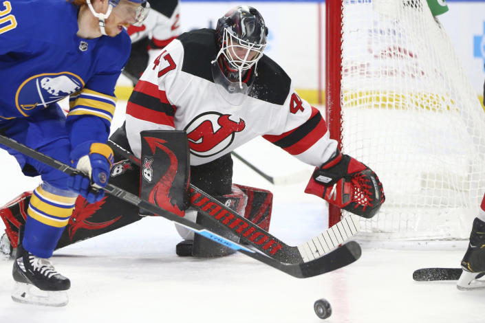 New Jersey Devils goalie Aaron Dell (47) watches the puck during the second period of the team's NHL hockey game against the Buffalo Sabres, Thursday, April 8, 2021, in Buffalo, N.Y. (AP Photo/Jeffrey T. Barnes)