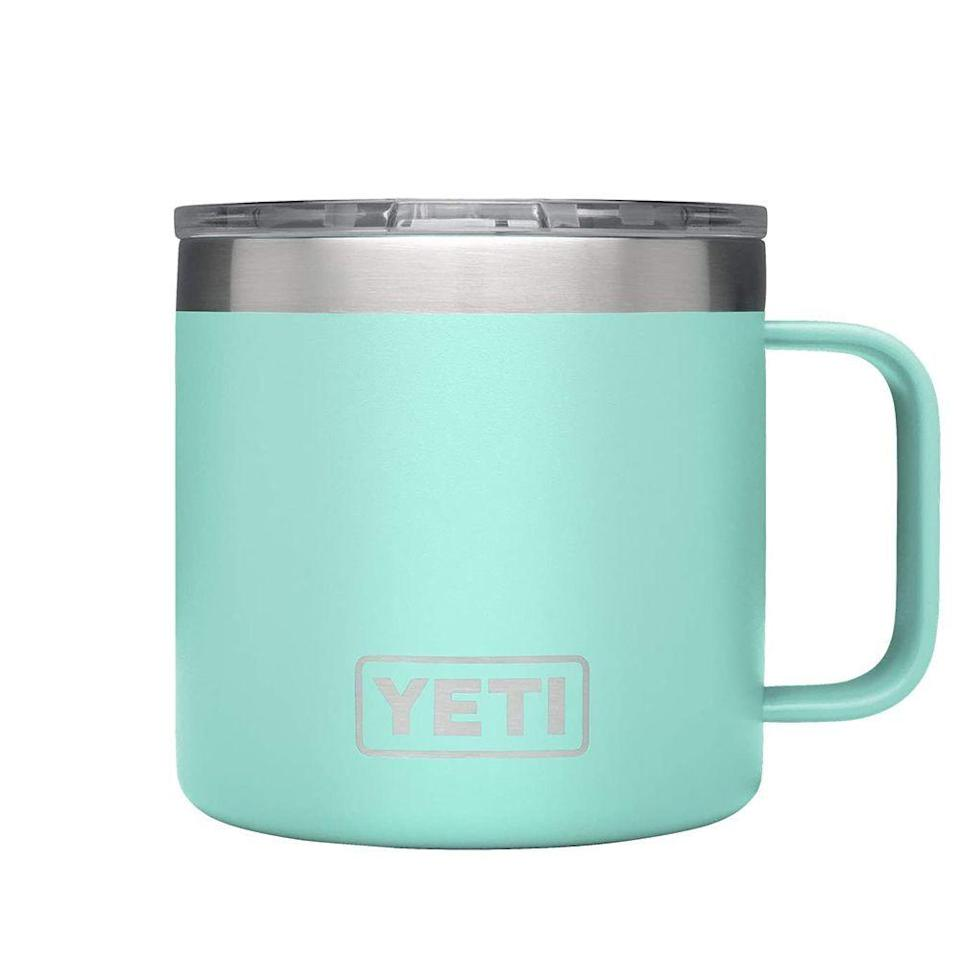 """<p><strong>YETI</strong></p><p>amazon.com</p><p><strong>$24.95</strong></p><p><a href=""""https://www.amazon.com/dp/B074W9T3MN?tag=syn-yahoo-20&ascsubtag=%5Bartid%7C2141.g.23308279%5Bsrc%7Cyahoo-us"""" rel=""""nofollow noopener"""" target=""""_blank"""" data-ylk=""""slk:Shop Now"""" class=""""link rapid-noclick-resp"""">Shop Now</a></p><p>Adventurous moms who like to go <a href=""""https://www.prevention.com/life/g32869392/hiking-essentials/"""" rel=""""nofollow noopener"""" target=""""_blank"""" data-ylk=""""slk:hiking and camping"""" class=""""link rapid-noclick-resp"""">hiking and camping</a> will love bringing this Yeti Rambler along for the journey. This BPA-free mug keeps coffee hot and iced water chilled thanks to a double-wall vacuum insulated construction. It's also very durable, surviving drops without scratches. We also like its handle, making it easy to drink from, but if Mom would rather a a tumbler, you can <a href=""""https://www.amazon.com/YETI-Rambler-Stainless-Insulated-MagSlider/dp/B073WJMKHN?tag=syn-yahoo-20&ascsubtag=%5Bartid%7C2141.g.23308279%5Bsrc%7Cyahoo-us"""" rel=""""nofollow noopener"""" target=""""_blank"""" data-ylk=""""slk:get one here"""" class=""""link rapid-noclick-resp"""">get one here</a>. </p>"""