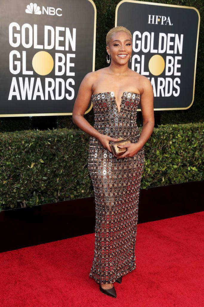 <p>The comedian and actress set the tone for the night early by coming out to present in this sleek, beaded metallic gown. The short blonde hair, gold clutch, and hoops all combined to turn this into a bold, strong and sexy look.</p>