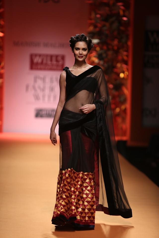 Bollywood's answer to Angelina Jolie, Esha Gupta walked the ramp for none other than ace designer Manish Malhotra.