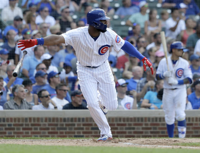 Chicago Cubs' Jason Heyward drops his bat as he watches his RBI single off Minnesota Twins relief pitcher Trevor Hildenberger during the seventh inning of a baseball game Saturday, June 30, 2018, in Chicago. David Bote scored. (AP Photo/Charles Rex Arbogast)