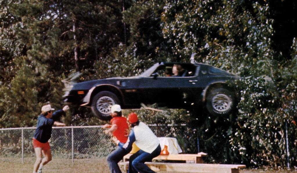 """1977 TRANS AM SPECIAL EDITION  As Seen In: <a href=""""http://movies.yahoo.com/movie/1800118781/info"""">Smokey and the Bandit</a>  Key Technical Specs: 6.6L V-8 engine; CB radio; totally sweet black and gold trim.    Rakish bootleggers who are long on charm and short on a respect for the law will love this baby. Whether you're outrunning Smokey, blasting through road blocks, or making improbable jumps over downed bridges, this is the car for you.    Available Options: Deluxe cooler to keep all that Coors beer cold."""
