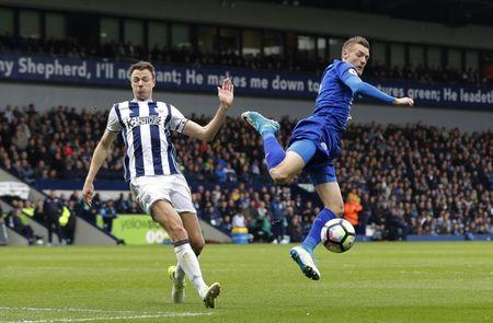 Leicester City's Jamie Vardy in action with West Bromwich Albion's Jonny Evans