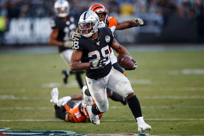OAKLAND, CA - NOVEMBER 17: Running back Josh Jacobs #28 of the Oakland Raiders rushes up field against the Cincinnati Bengals during the fourth quarter at RingCentral Coliseum on November 17, 2019 in Oakland, California. The Oakland Raiders defeated the Cincinnati Bengals 17-10. (Photo by Jason O. Watson/Getty Images)