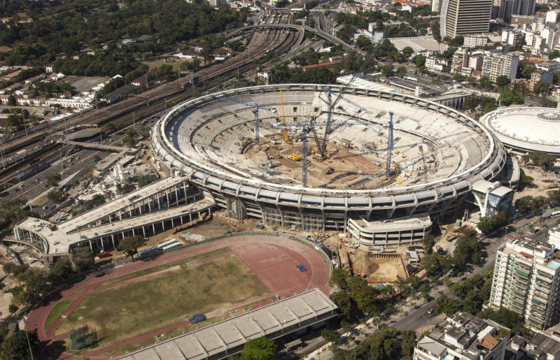 This September 2012 photo released by Ministerio do Esporte, shows an aerial view of the Maracana stadium, in Rio de Janeiro, Brazil. Brazil was granted permission by FIFA on Thursday to host the Confederations Cup with six venues including Rio de Janeiro, Salvador, Recife, Brasilia, Belo Horizonte and Fortaleza, as originally planned. FIFA had previously announced the six cities as hosts, but said Recife and Salvador would only be ratified if they showed significant improvement in their preparations. (AP Photo/Ministerio do Esporte, Daniel Basil)