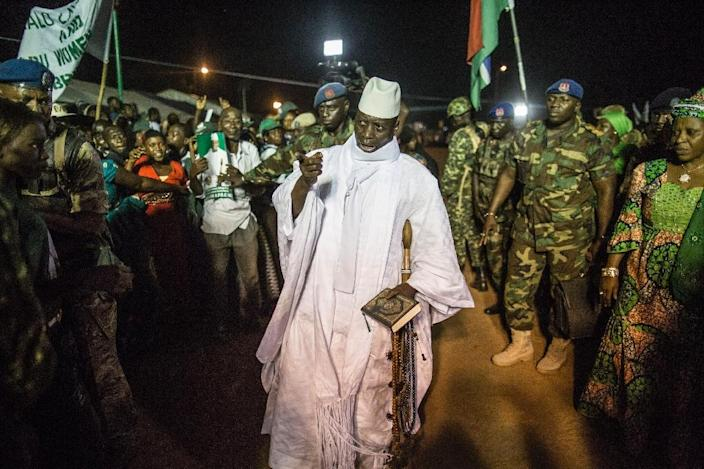 Gambia's incumbent president Yahya Jammeh (C) has refused to leave office, ignoring a midnight deadline Wednesday to stand down or face military action (AFP Photo/MARCO LONGARI)