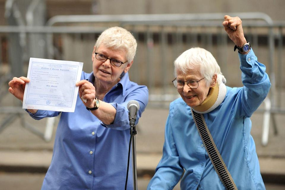 <p>Phyllis Siegel (left) and Connie Kopelov celebrate after they become the first same-sex couple to wed at Manhattan's City Clerk's Office. On July 24, New York became the sixth state allowing same-sex marriages — this was the first day couples were allowed to obtain a license and participate in a wedding ceremony. </p>