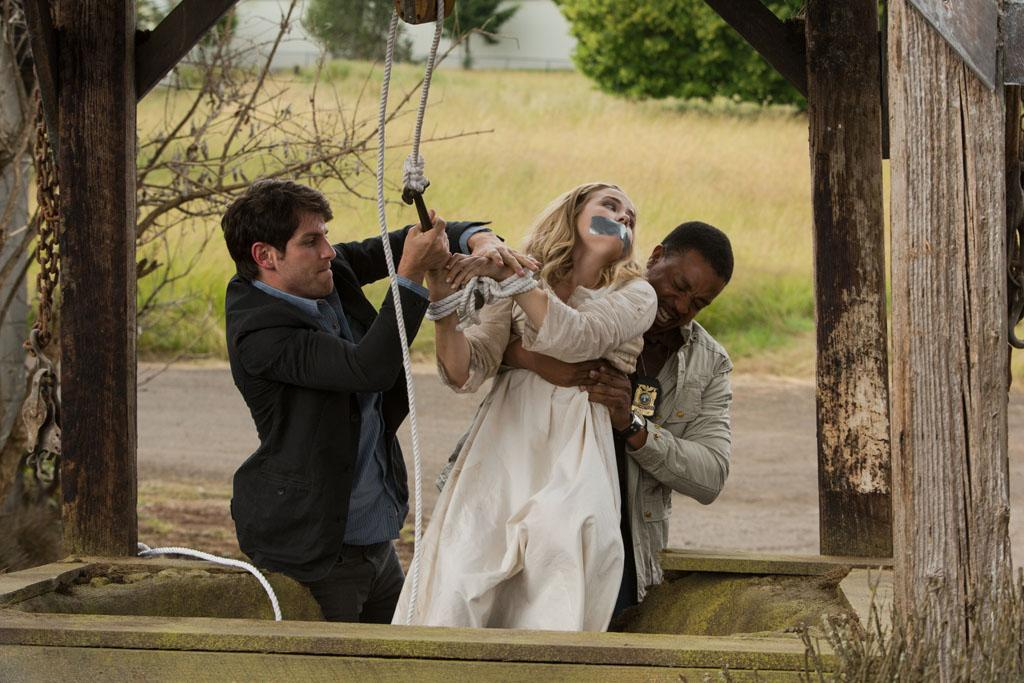 "David Giuntoli as Nick Burkhardt, Maddie Hasson as Carly and Russell Hornsby as Hank Griffin in the ""Grimm"" episode, ""Bad Moon Rising."""