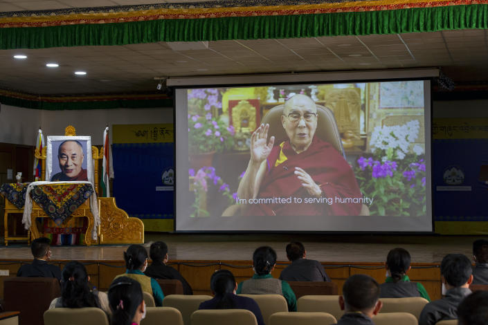 Exile Tibetan government officials watch a message from their spiritual leader the Dalai Lama on a screen during a ceremony to mark the 86th birthday of the Tibetan leader in Dharmsala, India, Tuesday, July 6, 2021. This year, due to the coronavirus pandemic, the celebrations were muted and behind closed doors. (AP Photo/Ashwini Bhatia)