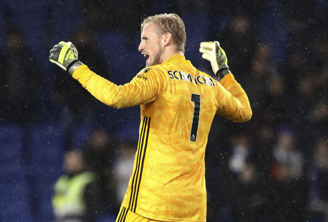 Leicester City goalkeeper Kasper Schmeichel celebrates the results at the end of the English Premier League soccer match between Brighton and Hove and Leicester City, at the AMEX Stadium, in Brighton, England, Saturday, Nov. 23, 2019. (Gareth Fuller/PA via AP)