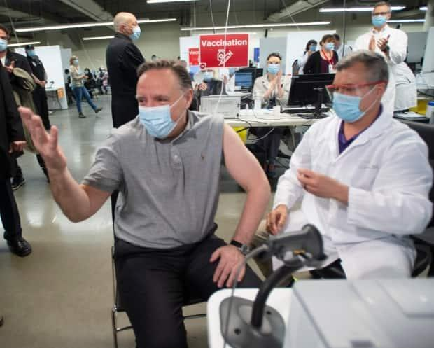 Quebec Premier François Legault gets a first vaccine dose on March 27, 2021. The premier said hospitalization projections show an increase in the days ahead, but still within the system's capacity. (Ryan Remiorz/The Canadian Press - image credit)