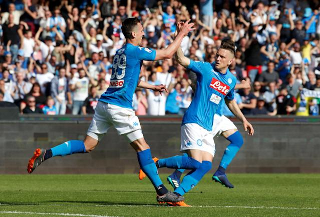 Napoli's Arkadiusz Milik celebrates the first of two late goals against Chievo Verona. (Reuters)
