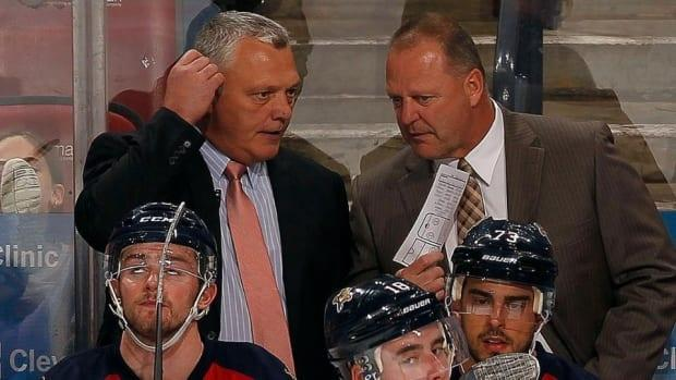 Mike Kelly, left, seen here with his fellow coach Gerard Gallant, says the Canadian team needs to 'keep it simple' to win tomorrow.  (NHL - image credit)