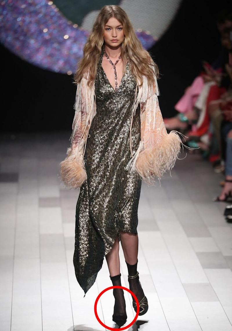 Just as Gigi Hadid hit the ramp at the Anna Sui show at New York Fashion Week on Monday, the 22-year-old's strappy heel on her right foot came off. Source: Getty