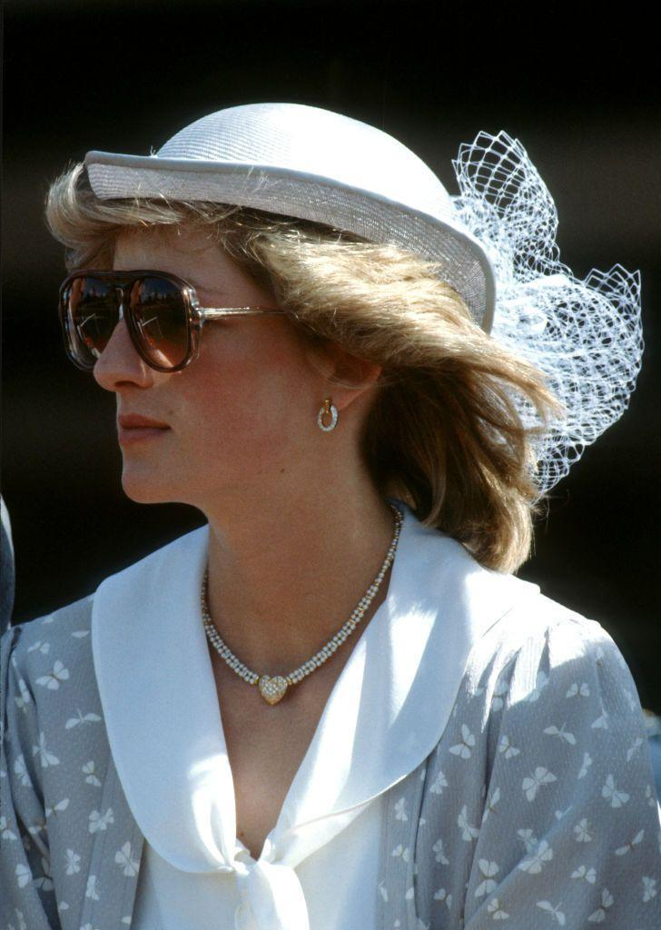 <p>Diana, Princess of Wales, wearing a grey and white, silk, butterfly patterned jacket and skirt designed by Caroline Charles, with a matching hat and sunglasses, during a visit to Bunbury on April 8, 1983 in Western Australia.</p>