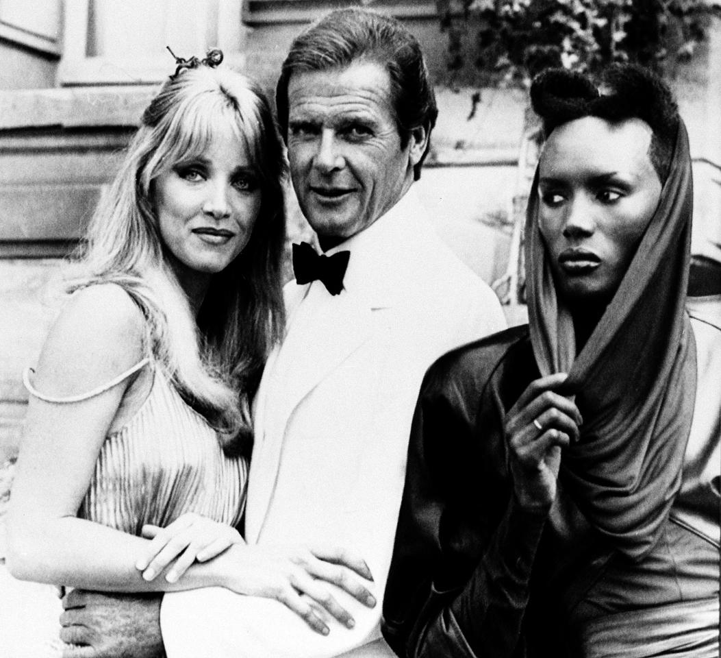 "FILE - In this Aug. 17, 1984 file photo, actor Roger Moore, alias British secret agent James Bond, is seen with his co-stars Tanya Roberts, and Grace Jones, right, in front of Chateau de Chantilly, on the set of the 007 action film ""A View to a Kill,"" near Paris, France. (AP Photo/Alexis Duclos, File)"
