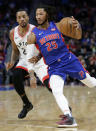 Detroit Pistons guard Derrick Rose (25) drives against Toronto Raptors guard Norman Powell during the first half of an NBA basketball game Wednesday, Dec. 18, 2019, in Detroit. (AP Photo/Duane Burleson)