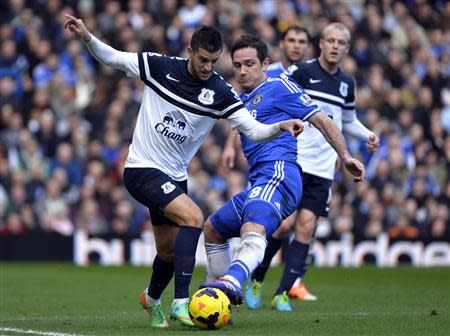 Chelsea's Lampard challenges Everton's Mirallas during their English Premier League soccer match at Stamford Bridge in London