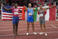 Gold medalist Lamont Marcell Jacobs, centre, of Italy, poses for a photo with silver medalist Fred Kerley, of the United States, and bronze medalist Andre de Grasse, right, of Canada, after the men's 100-meters the men's 100-meters at the 2020 Summer Olympics, Sunday, Aug. 1, 2021, in Tokyo. (AP Photo/David J. Phillip)