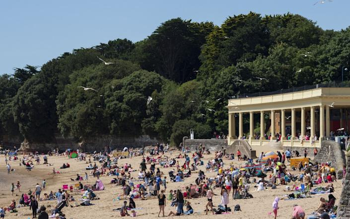 People enjoy the beach in Barry, Wales, as large part of the country's hospitality sector will re-open in the next three weeks - Getty Images Europe