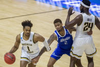 Wichita State's Tyson Etienne (1) uses a screen from teammate Morris Udeze (24) to move past Drake's TremellMurphy (2) during the first half of a First Four game in the NCAA men's college basketball tournament Thursday, March 18, 2021, at Mackey Arena in West Lafayette, Ind. (AP Photo/Robert Franklin)