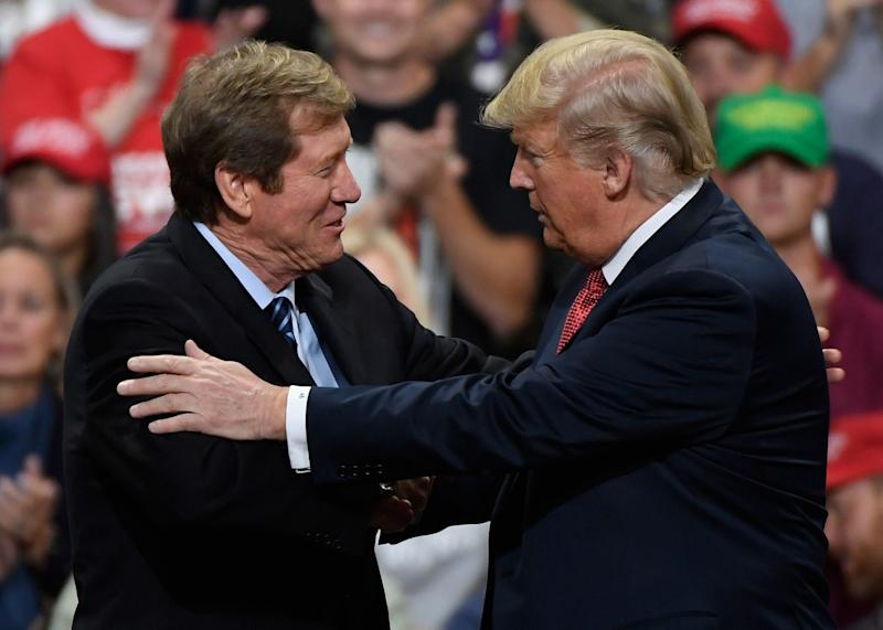 President Donald Trump greets then-Rep. Jason Lewis (R-Minn.) at a campaign rally on Oct. 4, 2018. (Photo: Hannah Foslien via Getty Images)