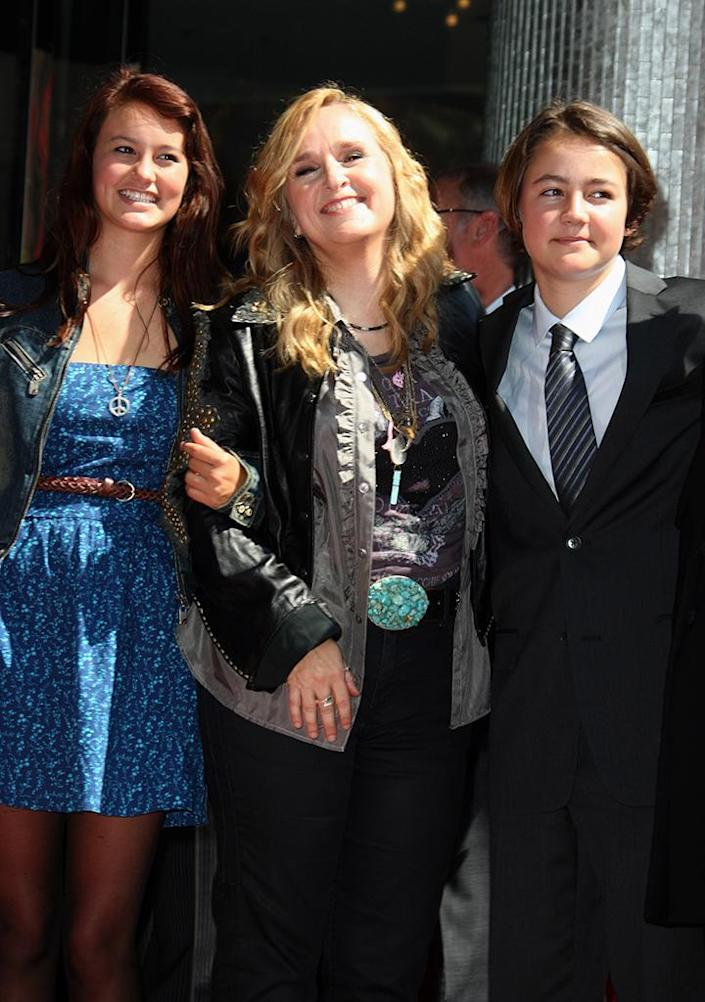 Melissa Etheridge poses with daughter Bailey Jean and son Beckett while receiving her star on the Hollywood Walk of Fame in 2011. (Photo: REX/Shutterstock)