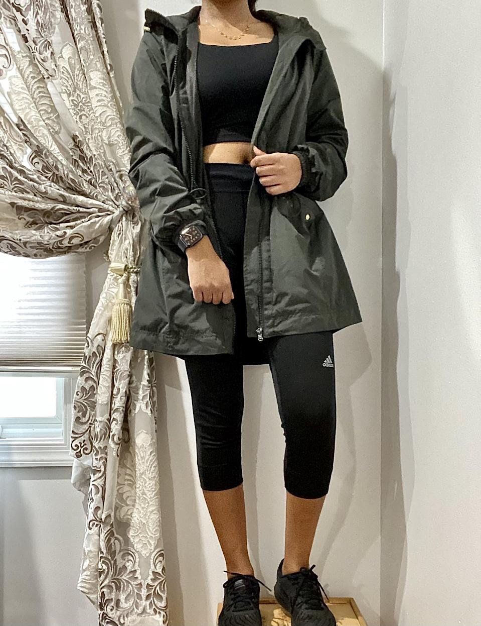 """<p><strong>The item:</strong> <span>Go-H20 Water-Resistant Hooded Anorak for Women</span> ($55)</p> <p><strong>What our editor said:</strong> """"I'm a petite person, and outerwear looks significantly oversized on me but not in a cute <a class=""""link rapid-noclick-resp"""" href=""""https://www.popsugar.com/Ariana-Grande"""" rel=""""nofollow noopener"""" target=""""_blank"""" data-ylk=""""slk:Ariana Grande"""">Ariana Grande</a> way, more like in an overwhelming way, like I'm being engulfed in a sea of jackets. What I love about this jacket is that it has an adjustable drawcord at the cinch of the waist. It gives the jacket some shape and makes me look like I have proper curves and not just wearing a poncho from a Niagara Falls tour. I also love that the cuffs of the sleeves are cinched in with elastic bands."""" - Anvita Reddy, editorial coordinator, Shop </p> <p>If you want to read more, here is the <a href=""""https://www.popsugar.com/fashion/old-navy-weather-proof-jacket-review-47963234"""" class=""""link rapid-noclick-resp"""" rel=""""nofollow noopener"""" target=""""_blank"""" data-ylk=""""slk:complete review"""">complete review</a>.</p>"""