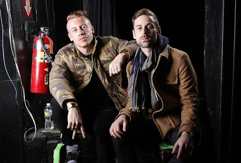FILE - This Nov. 20, 2012 file photo shows Ben Haggerty, better known by his stage name Macklemore, left, and his producer Ryan Lewis at Irving Plaza in New York. It was announced Tuesday, Sept. 17, 2013 that Justin Timberlake and Macklemore & Ryan Lewis lead the 2013 MTV EMA nominations with five nods each. The 2013 MTV EMAs will be held at Amsterdam's Ziggo Dome on Nov. 10. (Photo by Carlo Allegri/Invision/AP, file)