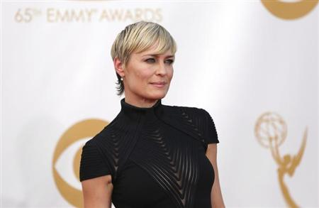 """Robin Wright from the Netflix series """"House of Cards"""" arrives at the 65th Primetime Emmy Awards in Los Angeles September 22, 2013. REUTERS/Mario Anzuoni/Files"""