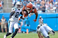 <p>Tyler Boyd #83 of the Cincinnati Bengals runs the ball against James Bradberry #24 of the Carolina Panthers in the first quarter during their game at Bank of America Stadium on September 23, 2018 in Charlotte, North Carolina. (Photo by Grant Halverson/Getty Images) </p>