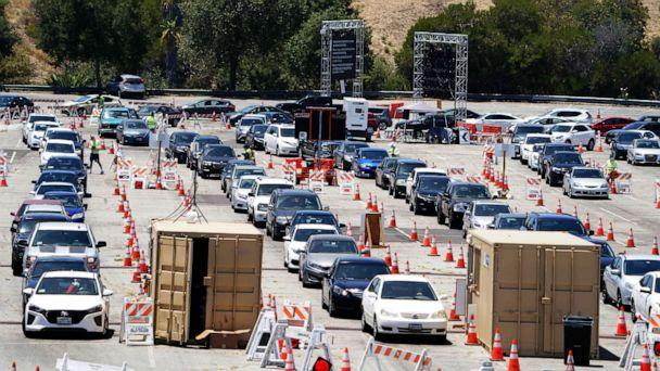 PHOTO: Cars enter the coronavirus COVID-19 testing site at Dodger Stadium, July 13, 2020, in Los Angeles, California. (Kirby Lee/USA TODAY Sports)