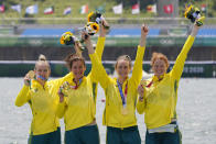 Lucy Stephan, Rosemary Popa, Jessica Morrison and Annabelle McIntyre, of Australia, celebrate with the gold medal following the women's rowing four final at the 2020 Summer Olympics, Wednesday, July 28, 2021, in Tokyo, Japan. (AP Photo/Darron Cummings)