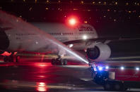 The last Lufthansa flight of the Airbus A350 aircraft from Tegel Airport is taxiing to the take-off field as it is bid farewell by the airport fire brigade with a fountain of water, in Berlin, Germany, Saturday, Nov. 7, 2020. The final flight is scheduled for Sunday. (Fabian Sommer/dpa via AP)