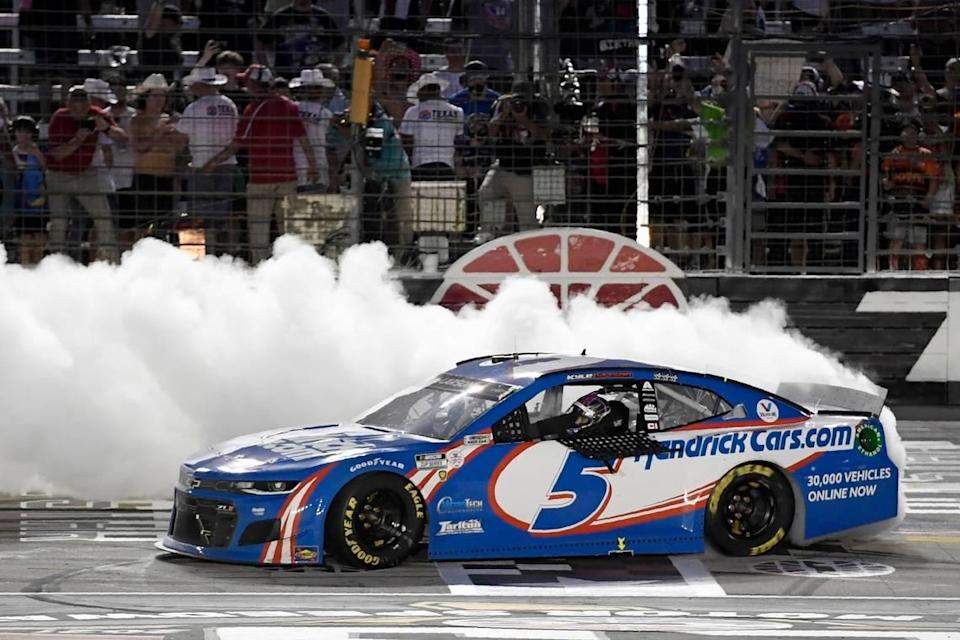 Kyle Larson celebrates on the front stretch after winning the NASCAR Cup Series All-Star auto race at Texas Motor Speedway in Fort Worth, Texas, Sunday, June 13, 2021. (AP Photo/Larry Papke)