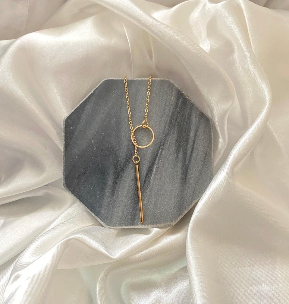 <p>This <span>Lariat Necklace Bar</span> ($14) will pair well with a plunging neckline.</p>