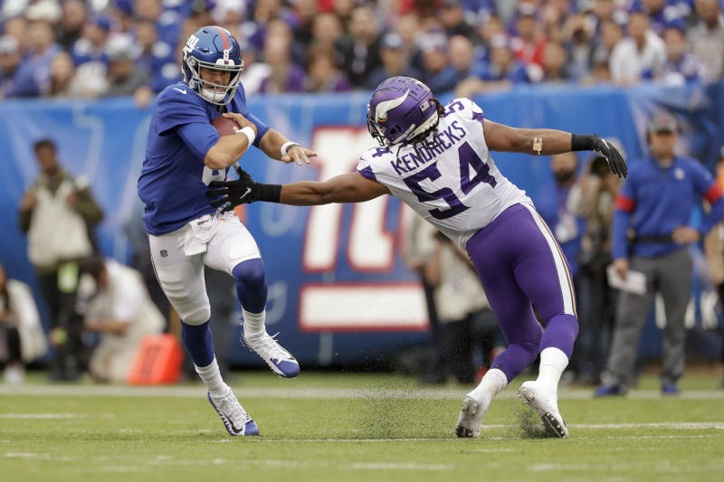 New York Giants quarterback Daniel Jones (8) avoids a tackle by Minnesota Vikings middle linebacker Eric Kendricks (54) during the second quarter of an NFL football game, Sunday, Oct. 6, 2019, in East Rutherford, N.J. (AP Photo/Adam Hunger)