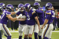 Minnesota Vikings punter Jordan Berry (3) is congratulated by teammates after a punt to the 1-yard-line to the Seattle Seahawks in the second half of an NFL football game in Minneapolis, Sunday, Sept. 26, 2021. (AP Photo/Jim Mone)