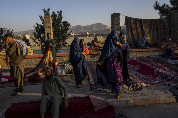 FILE - In this Wednesday, Sept. 15, 2021, file photo, Afghan women walk through a second-hand market where many families sold their belongings before leaving the country or due to financial struggle, in Kabul, Afghanistan. On Friday, Sept. 17, 2021, The Associated Press reported on stories circulating online incorrectly asserting that CNN had reported that the Taliban banned menstrual hygiene products in Afghanistan, saying it goes against Sharia law. CNN did not publish such an article and no credible reports can be found to support any such action by the Taliban. A closer look at the post shows that the CNN logo was flipped and the font does not match the cable news network's logo. (AP Photo/Bernat Armangue, File)