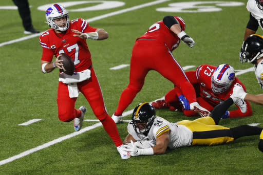 Buffalo Bills quarterback Josh Allen (17) is forced out of the pocket by Pittsburgh Steelers linebacker Alex Highsmith (56) during the first half of an NFL football game in Orchard Park, N.Y., Sunday, Dec. 13, 2020. (AP Photo/Jeffrey T. Barnes )
