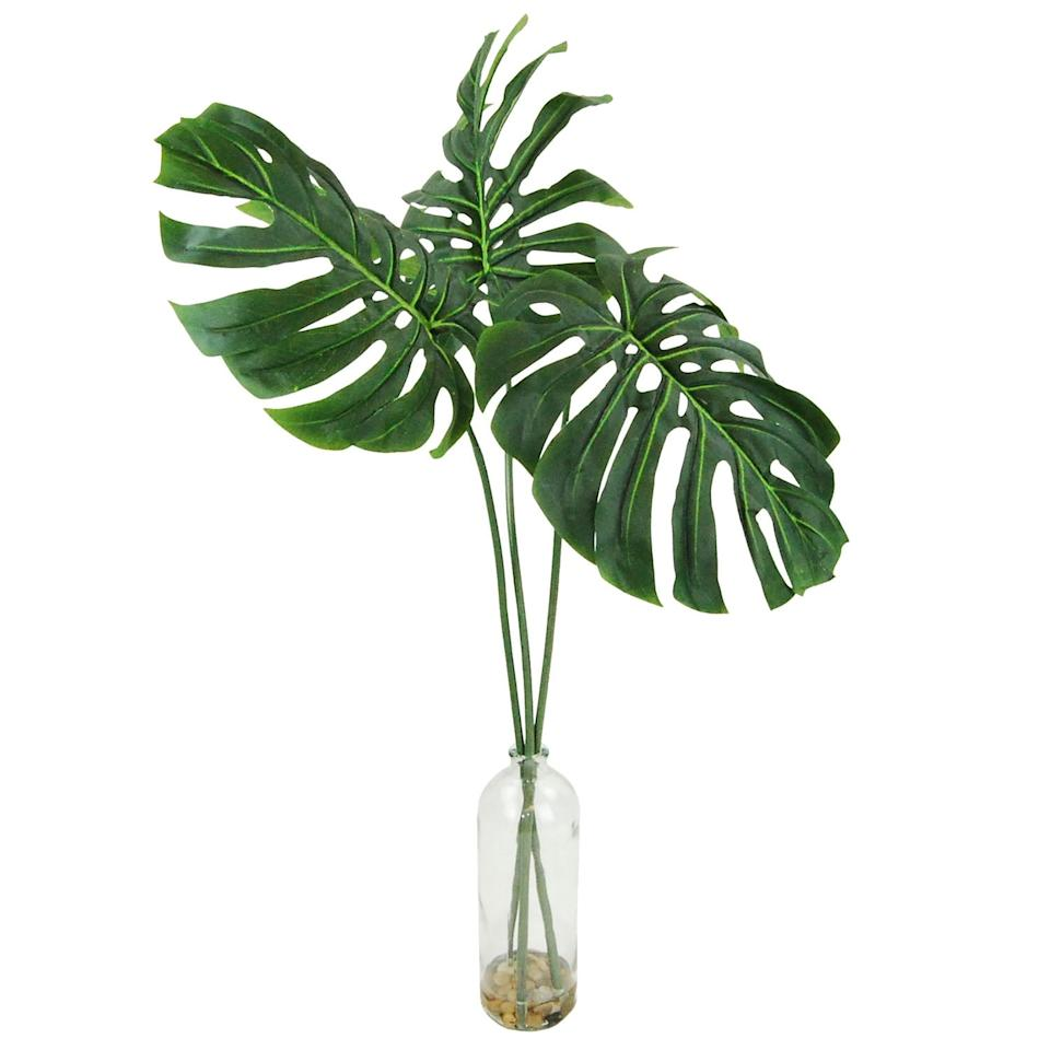 """<p>If you have an empty corner that could use filling, the <a href=""""https://www.popsugar.com/buy/Philodendron-Leaves-Chunky-Glass-Bottle-Silk-Plant-472281?p_name=Philodendron%20Leaves%20in%20a%20Chunky%20Glass%20Bottle%20Silk%20Plant&retailer=pier1.com&pid=472281&price=40&evar1=casa%3Aus&evar9=46420058&evar98=https%3A%2F%2Fwww.popsugar.com%2Fhome%2Fphoto-gallery%2F46420058%2Fimage%2F46420095%2FPhilodendron-Leaves-Chunky-Glass-Bottle-Silk-Plant&list1=pier%201%2Cdecor%20shopping%2C50%20under%20%2450&prop13=mobile&pdata=1"""" rel=""""nofollow"""" data-shoppable-link=""""1"""" target=""""_blank"""" class=""""ga-track"""" data-ga-category=""""Related"""" data-ga-label=""""https://www.pier1.com/philodendron-leafs-in-a-chunky-glass-bottle--silk-plant/3473774.html?cgid=artificial-trees#srule=price-low-to-high&amp;origin=gridswatch"""" data-ga-action=""""In-Line Links"""">Philodendron Leaves in a Chunky Glass Bottle Silk Plant</a> ($40, originally $50) will bring it to life. </p>"""