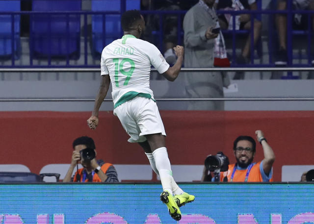 Saudi Arabia's forward Fahad Al Muwallad, celebrates his opening goal, during the AFC Asian Cup group E soccer match between Lebanon and Saudi Arabia at Al Maktoum Stadium in Dubai, United Arab Emirates, Saturday, Jan. 12, 2019. (AP Photo/Hassan Mammar)