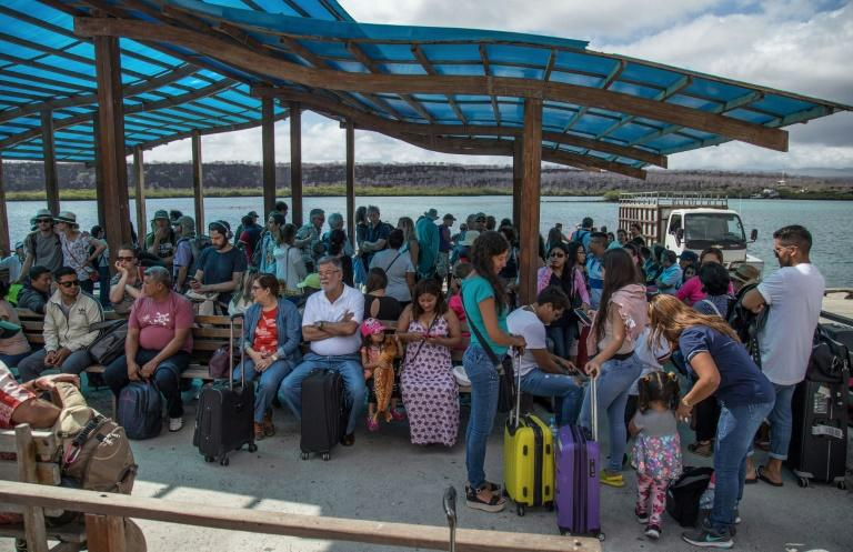 A group of tourists arrive on Santa Cruz Island after crossing the Itabaca channel in the Galapagos -- by law, even Ecuadorans from the mainland are treated as foreigners on the islands