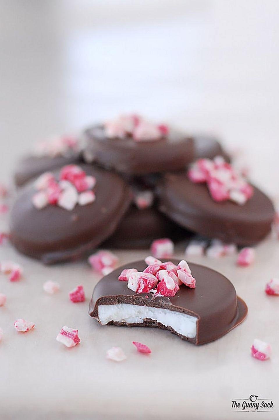 """<p>These homemade peppermint patties get a dose of Christmas cheer from crushed candy canes sprinkled on top.</p><p><strong>Get the recipe at <a href=""""http://www.thegunnysack.com/peppermint-patties-recipe-and-a-giveaway-from-country-door/"""" rel=""""nofollow noopener"""" target=""""_blank"""" data-ylk=""""slk:The Gunny Sack"""" class=""""link rapid-noclick-resp"""">The Gunny Sack</a>.</strong> </p>"""