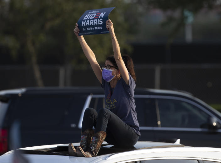 A supporters holds up a sign during a get out the vote event featuring Jill Biden, wife of Democratic presidential candidate former Vice President Joe Biden, Tuesday, Oct. 13, 2020, at NRG Stadium parking lot in Houston. (Yi-Chin Lee/Houston Chronicle via AP)