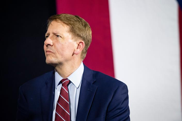 Richard Cordray listens while former President Barack Obama speaks during a campaign rally at CMSD East Professional Center Gymnasium on Sept. 13, 2018, in Cleveland, Ohio. (Photo: Angelo Merendino via Getty Images)