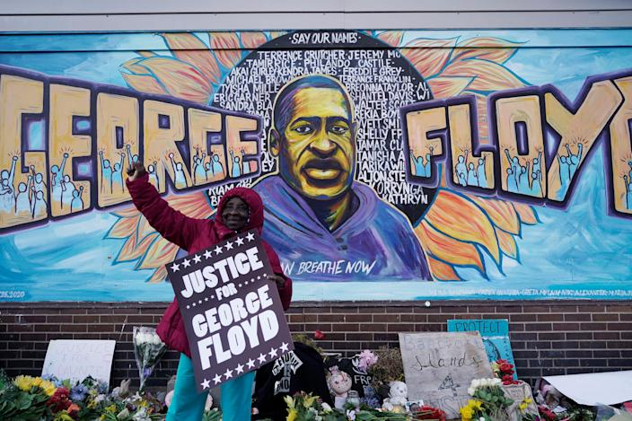 People celebrate the guilty verdict against former Minneapolis police officer Derek Chauvin at the Cup Foods where George Floyd died under Chauvin's knee in Minneapolis.